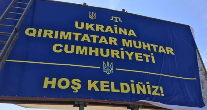 Billboard welcoming to Crimean Tatar Republic set up at entrance to Crimea