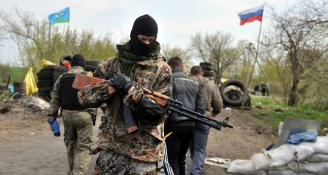 Militants keep watch over southerly direction and shell it