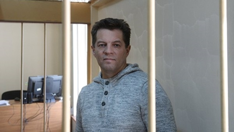 Banner with Roman Sushchenko installed near Russian Embassy in Kyiv