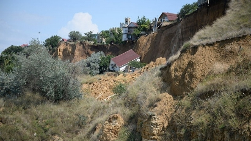 In Sevastopol, trees cut down over hillside where construction started. Townspeople fear another landslide